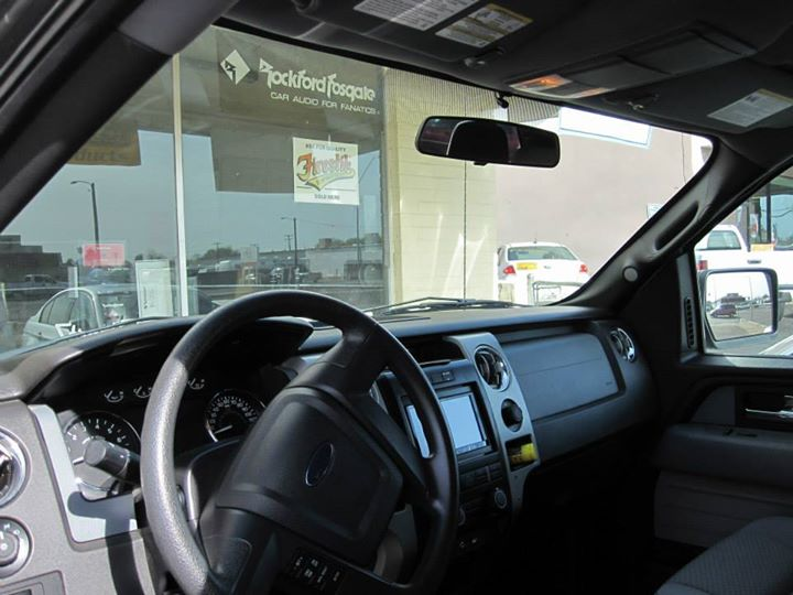 Bluetooth microphone above rear view mirror.